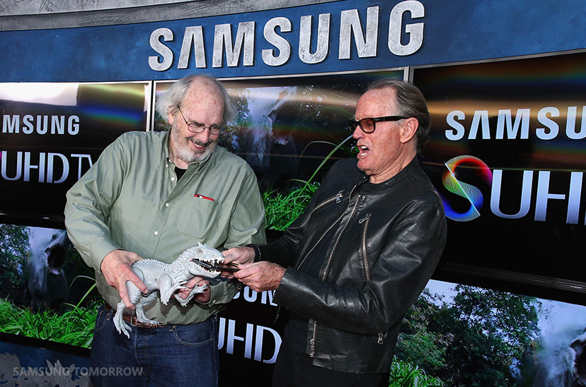 Actor Peter Fonda (L) and Paleontologist consultant Jack Horner poses in front of Samsung's SUHD TVs at the premiere of Jurassic World at Dolby Theatre on June 9, 2015 in Hollywood, California.