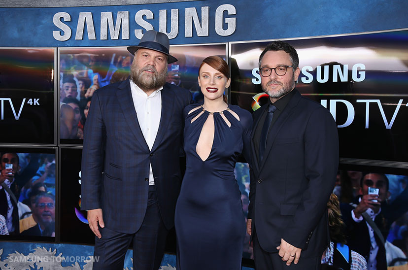 Actors Vincent D'Onofrio, Bryce Dallas Howard and Writer Director Colin Trevorrow pose in front of Samsung's SUHD TVs at the premiere of Jurassic World at Dolby Theatre on June 9, 2015 in Hollywood, California