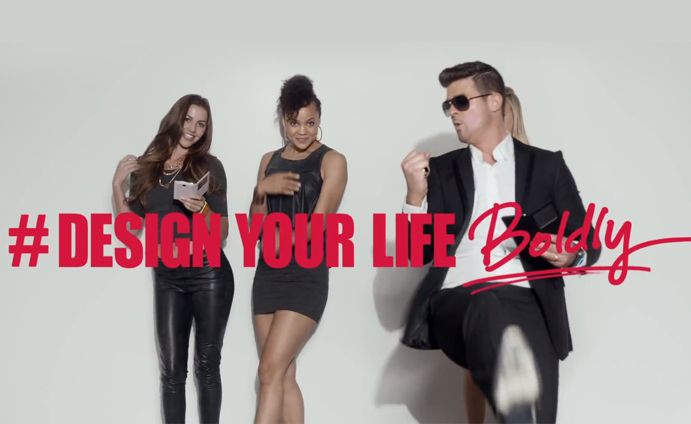 Robin Thicke in a music video with the girls from the commercial