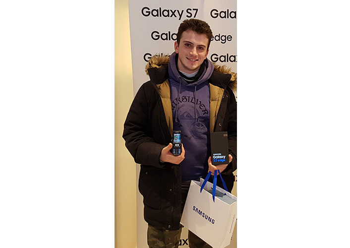 The first person to buy a Galaxy S7 edge at one Paris store. He said he had been using a Samsung D500 phone for the last 12 years.