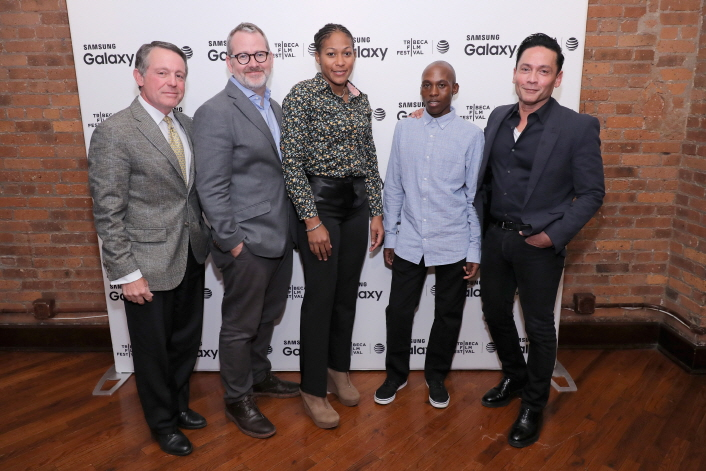 "MC Jimmy Roberts, Director Morgan Neville, and featured athletes Yenebier Guillen Benitez and Tsepo Mathibelle pose at ""A Fighting Chance"" Premier Event at Tribeca Film Center"