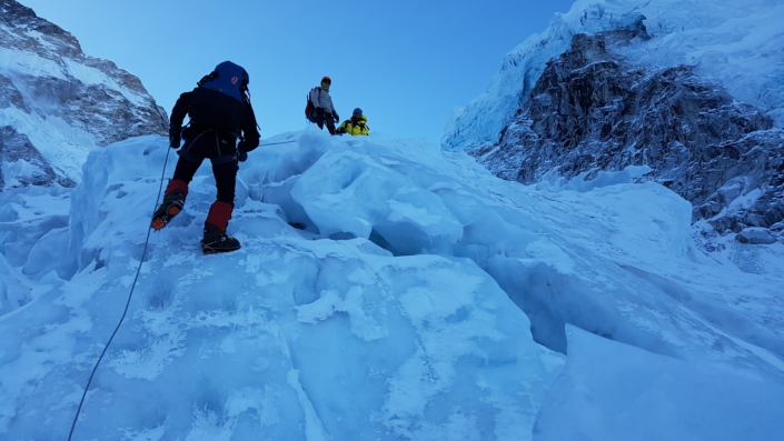 Young-Ho Heo and his team climbing up the icy mountains, being careful not to slip.