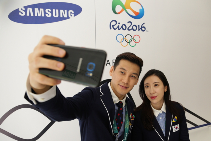 South Korea fencers Gu Bon-Gil, left, and Shin A-Lam receive their Samsung Galaxy S7 edge Olympic Games Limited Edition at the Samsung Galaxy Studio in the Rio 2016 Olympic Village in Rio de Janeiro, Brazil.