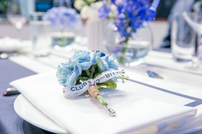 Guests were given blue boutonnieres and bracelets to wear during the party. Like most of the décor, they were signature Samsung blue.