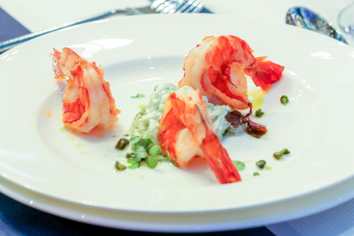 The appetizer was grilled tiger prawns with cucumber salad and pistachio yogurt dressing—available on the Club des Chefs app, courtesy of Chef Michel Roux.