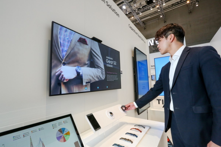 Customers can interact with the sensor-integrated touch screen display to learn more information about the selected product.