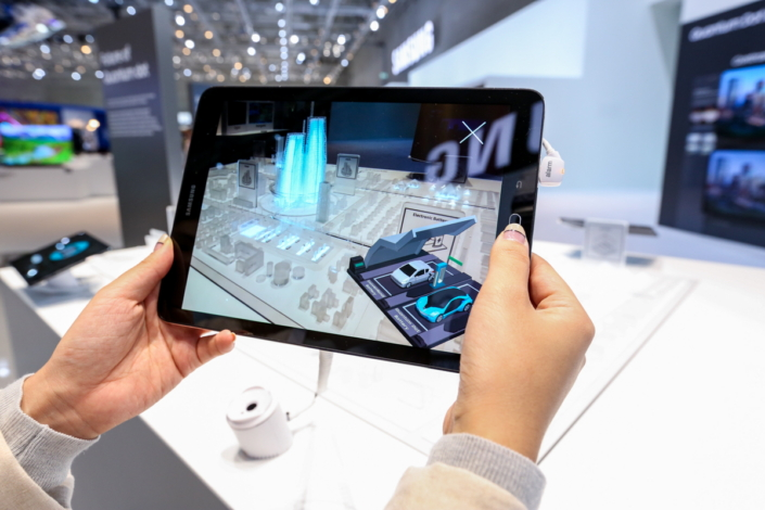 A guest views an augmented-reality example of QD technology's possible future applications.