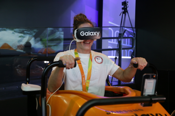 Team USA Paralympic Track and Field Athlete, Tatyana McFadden, is all smiles as she experiences the high-speed thrill of simulated Olympic kayaking through 4D motion virtual reality at the Samsung Galaxy Studio Olympic Park in Rio de Janeiro, Brazil on September 10th, 2016. The film is displayed through the Samsung Galaxy smartphone and Gear VR.