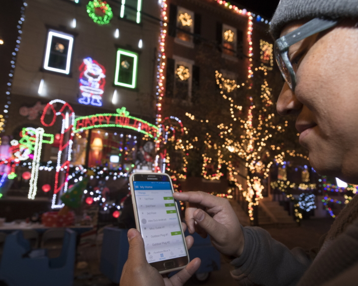 Alexander Du, a resident of Miracle on South 13th Street in Philadelphia, controls his holiday lights at the tap of an app thanks to Samsung SmartThings smart home devices.